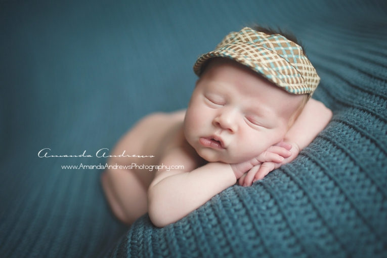 newborn sleeping on blue blanket