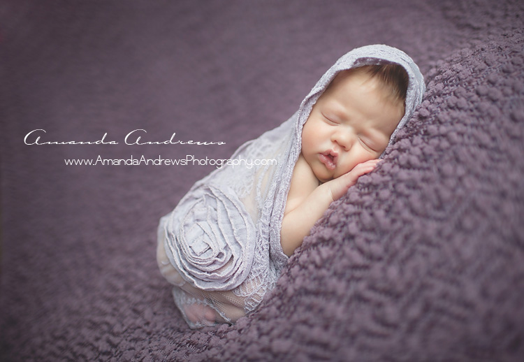 sleeping infant wrapped in purple boise idaho