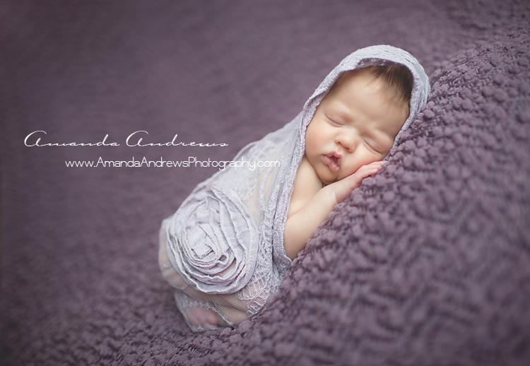 sleeping infant wrapped in purple boise idaho