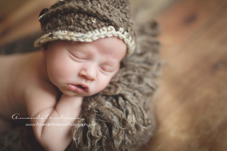 sleeping baby with brown hat on